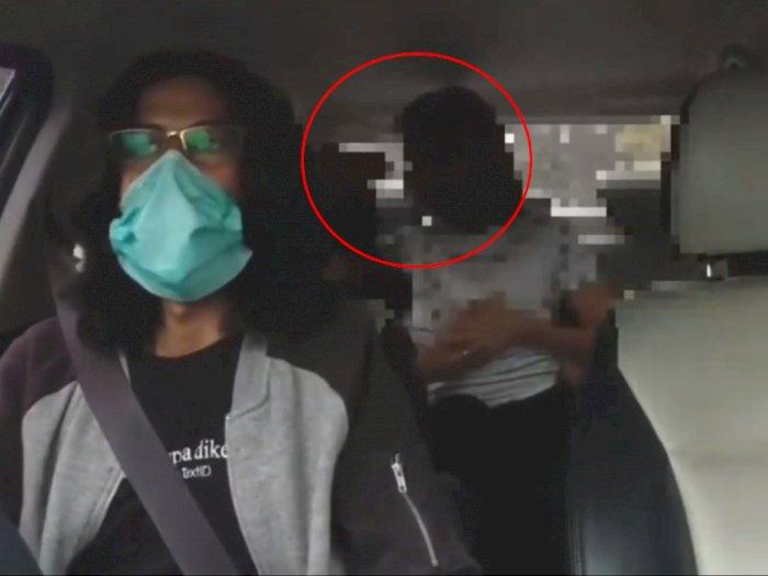 Viral Video Sejoli Penumpang Mesum dalam Taksi Online, Kepergok Cium dan Pegangi Payudara