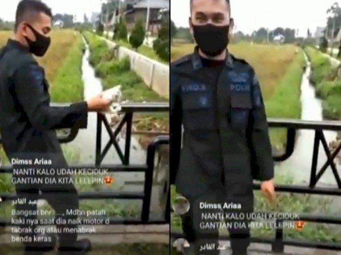 Parah! Pria Berseragam Ini Lempar Anak Kucing yang Masih Hidup ke Selokan, Netizen Geram