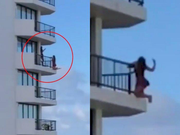 Demi Totalitas Sebuah Foto, Wanita Ini Nekat Bergantung di Balkon Lantai 11 Hotel