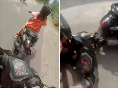 Video Pemuda yang Terjatuh Gegara Bocah yang Mengendarai Motor Belok Tiba-tiba