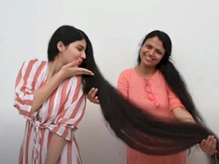 Penuh Haru, Remaja Pemilik Rambut Terpanjang di Dunia Potong Mahkotanya