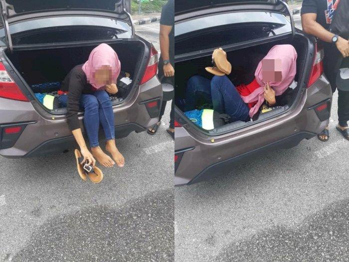 Wanita Indonesia Tertangkap Coba Lintasi Perbatasan Negara dengan Sembunyi di Bakasi Mobil