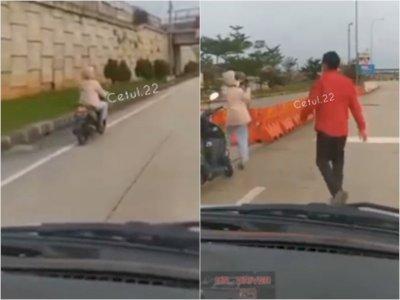 Wanita Naik Motor Terjebak di Jalan Tol Mau Lawan Arah, Beruntung Ada Pria Lakukan Hal Ini