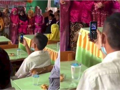 Pria Ini Tetap Rekam Penampilan Anak Meski Pakai Hp Jadul, Bikin Netizen Tersentuh