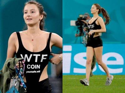 Wanita yang Ganggu Laga Finlandia Vs Belgia Ini Malah Mempromosikan Cryptocurrency