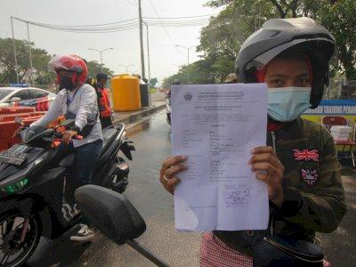 FOTO: Pemberlakuan Surat Izin Keluar Masuk di Jembatan Suramadu