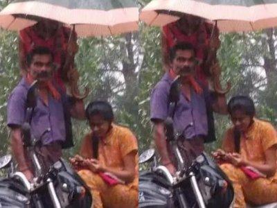 Potret Ayah Pegang Payung saat Putrinya Hadiri Kelas Online di Tengah Hujan, Netizen Salut