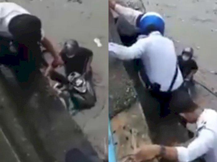 Salut! Polisi Lalu Lintas Dipuji Setelah Menyelamatkan Keluarga yang Terjebak Banjir