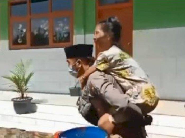 Polisi Baik Hati Bripka Hamsun Bisri, Gendong Lansia Disabilitas ke Lokasi Vaksin