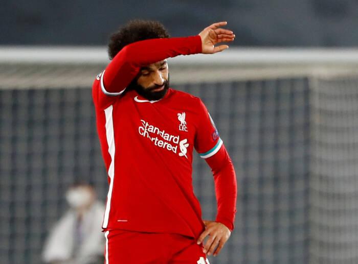 Mohamed Salah dari Liverpool bereaksi setelah pemain Real Madrid Marco Asensio mencetak gol kedua mereka