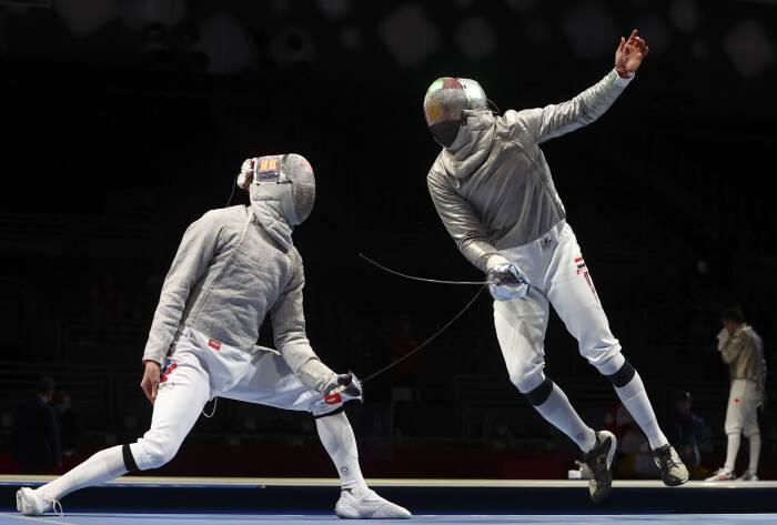 Ziad Elsissy dari Mesir beraksi melawan Veniamin Reshetnikov dari Komite Olimpiade Rusia